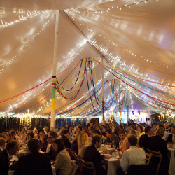 Streamers & fairy lights in a traditional marquee built in Bath by Archers Marquees