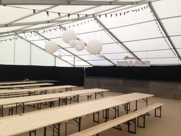 Beer festival tables and benches in a clearspan marquee