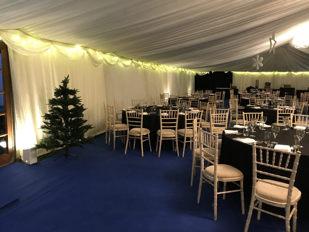 Uplighters and fairy lights in a clearspan corporate marquee