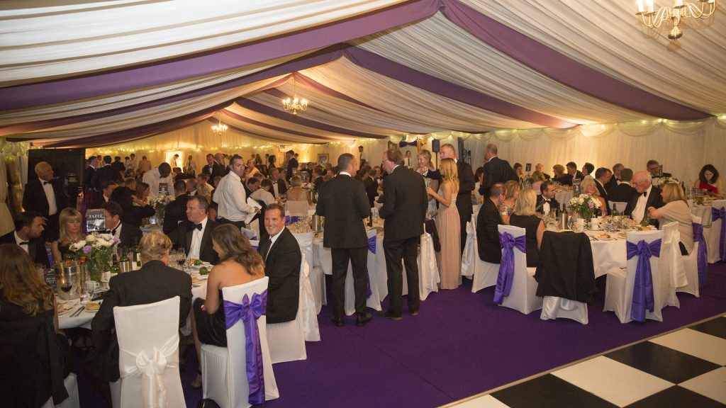 Chandeliers, uplighters and fairy lights in a clearspan corporate marquee