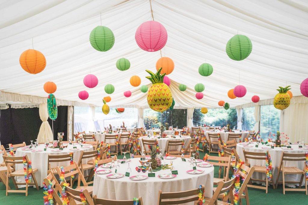 Pink, orange and green paper lanterns in a clearspan wedding marquee built in Bath by Archers Marquees