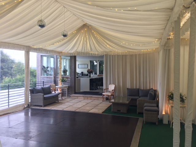 Clearspan marquee on 3m legs as extension to house for a party, with a dancefloor , linings and fairylights.