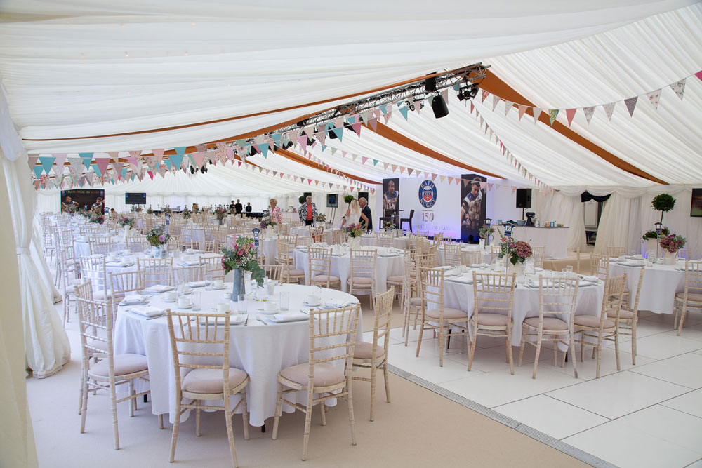 Pleated ivory lining in a clearspan corporate marquee