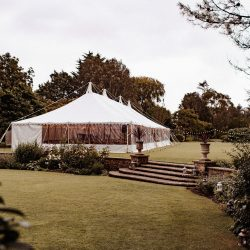 Traditional marquee with festoon lighting built by Archers Marquees at Whitelackington Manor in Taunton, Somerset for a summer wedding