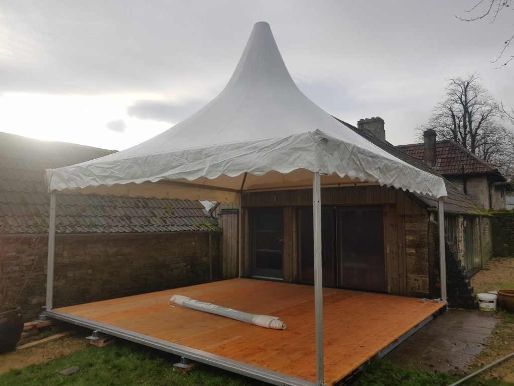 Wooden sub-frame floor in a Chinese Hat or Pagoda Marquee built extending off a barn in Bath by Archers Marquees