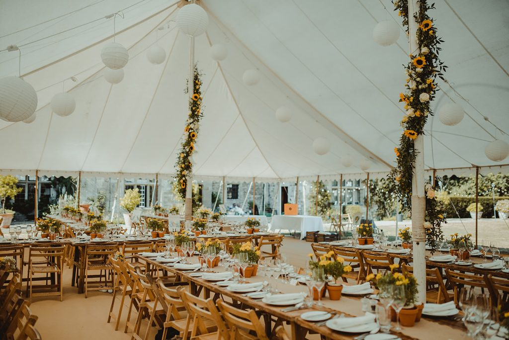 Inside of a traditional marquee built by Archers Marquees for a summer wedding in Bath.