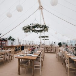 Flower Hoops in a traditional marquee built by Archers Marquees