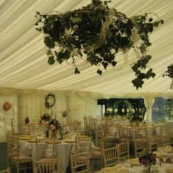 Ivy Hanging Balls in a clearspan marquee built by Archers Marquees