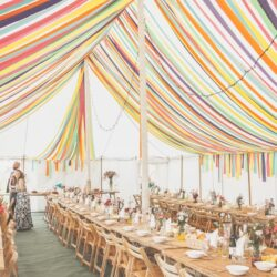 Colourful Streamers inside a traditional marquee, built by Archers Marquees
